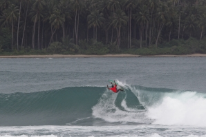 ndonesian surf star Dede Suryana (IDN) attacking the lip on Day 1 of the Nias Pro.