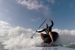 Kelly Slater surfing with a beanbag