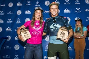 Caption: Courtney Conlogue (USA) and Julian Wilson (AUS) celebrate their wins at the 2018 Roxy Pro and Quiksilver Pro France.  Credit: © WSL / Poullenot